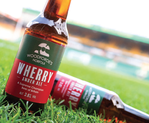 Woodforde's Brewery's flagship ale now in recyclable plastic bottles from Aston Manor.